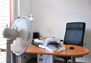 Standing fans keep offices cool in hot weather